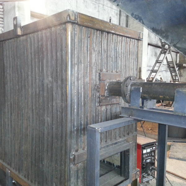 Котёл КВм-0,4 на древесных отходах со шнековой подачей