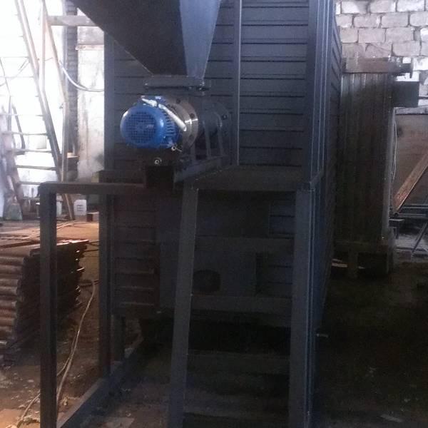 Котёл КВм-0,93 на древесных отходах со шнековой подачей и ворошителем