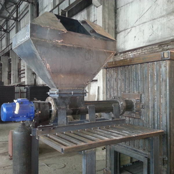 Котёл КВм-1,65 на древесных отходах со шнековой подачей