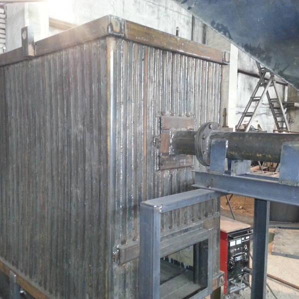 Котёл КВм-0,9 на древесных отходах со шнековой подачей и ворошителем
