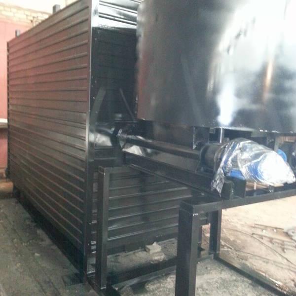 Котёл КВм-1,9 на древесных отходах со шнековой подачей и ворошителем