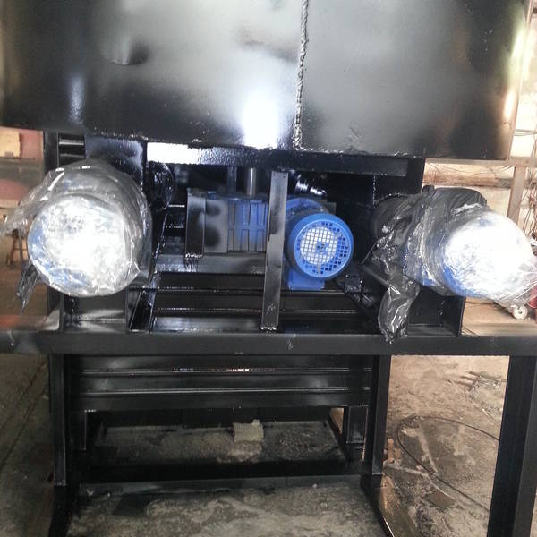 Котёл КВм-2,4 на древесных отходах со шнековой подачей и ворошителем