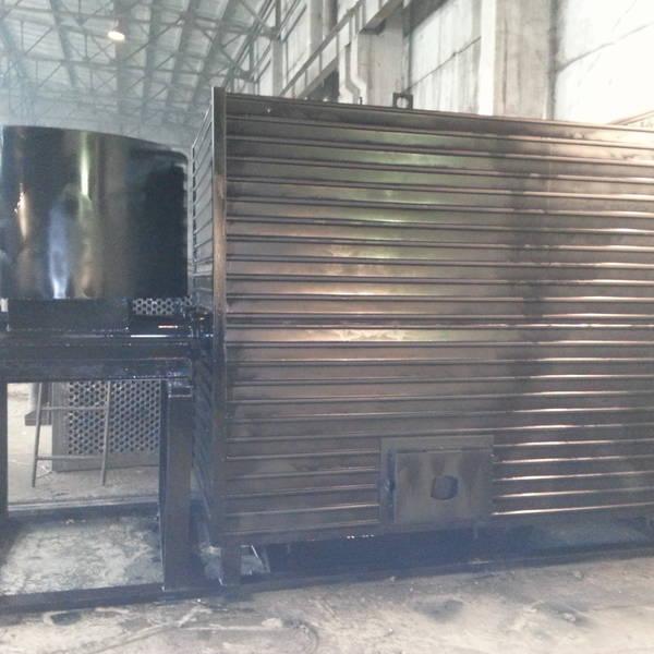 Котёл КВм-5,55 на древесных отходах со шнековой подачей и ворошителем